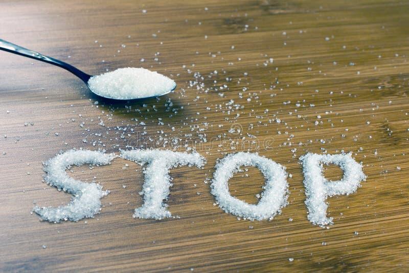 Κουτάλι στάσεων επιγραφής ζάχαρης ful της ζάχαρης στοκ εικόνα