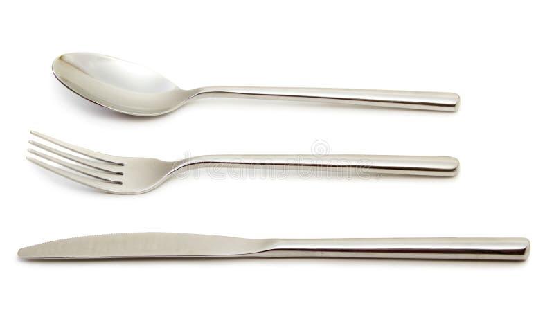 Κουτάλι, δίκρανο και μαχαίρι στοκ εικόνες