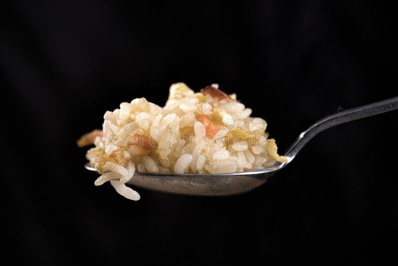 κουταλιά του τηγανισμένου ρυζιού στοκ εικόνα
