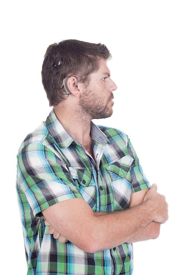 Κουφό άτομο με το κοχλιωτό μόσχευμα στοκ φωτογραφία