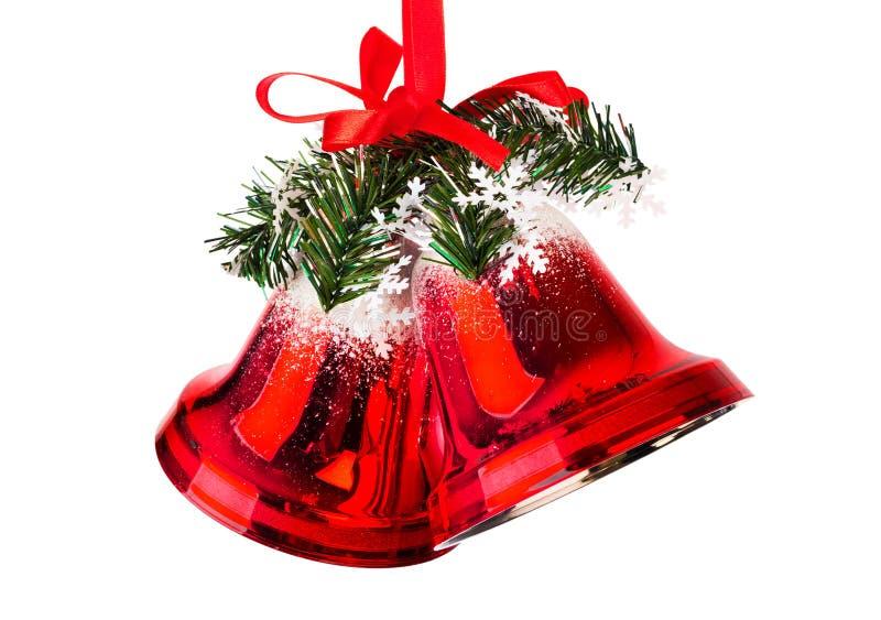 Κουδούνια Χριστουγέννων με ένα κόκκινο τόξο στοκ εικόνα με δικαίωμα ελεύθερης χρήσης