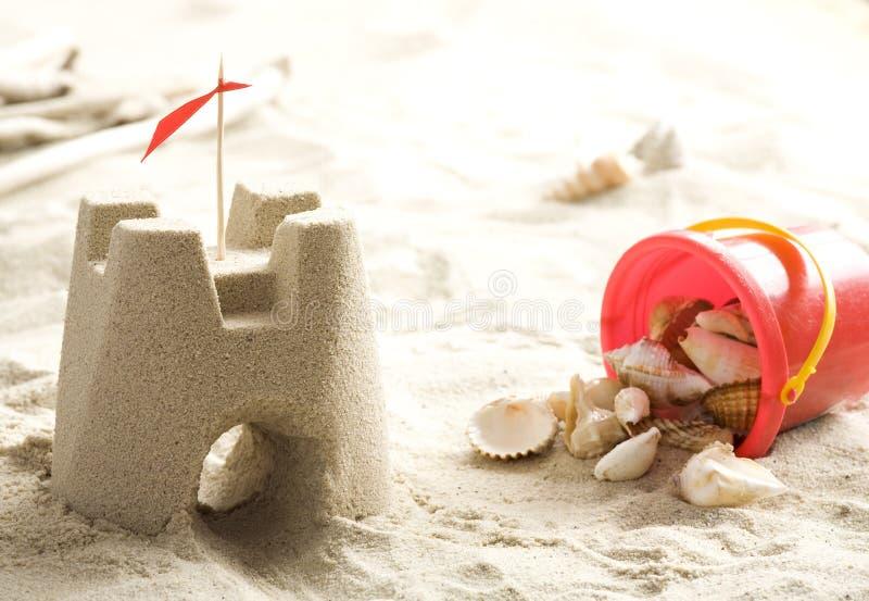 κοχύλια άμμου κάστρων στοκ εικόνα με δικαίωμα ελεύθερης χρήσης