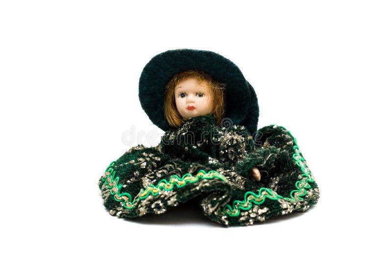 Κούκλα πορσελάνης σε ένα πράσινο φόρεμα στοκ φωτογραφία με δικαίωμα ελεύθερης χρήσης