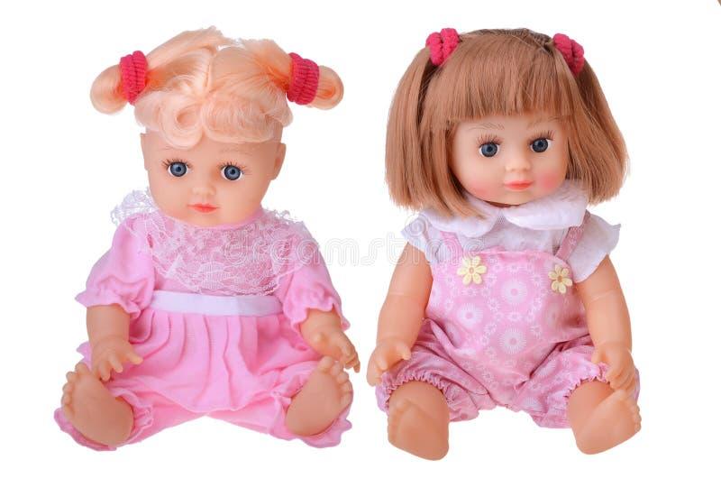 Κούκλες κοριτσιών που κάθονται στο ζωηρόχρωμο φόρεμα στοκ φωτογραφίες με δικαίωμα ελεύθερης χρήσης