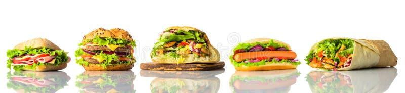 Κολάζ σάντουιτς και Burger στο άσπρο υπόβαθρο στοκ φωτογραφία