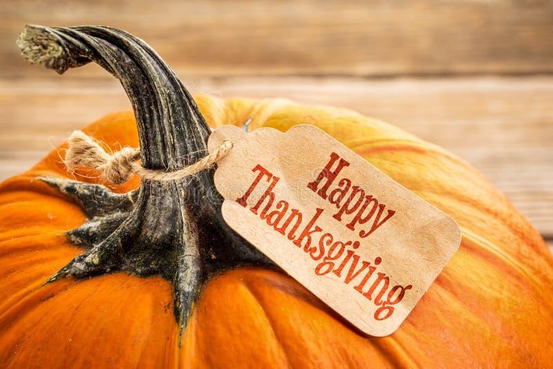 Κολοκύθα με την ευτυχή ετικέττα ημέρας των ευχαριστιών στοκ εικόνα με δικαίωμα ελεύθερης χρήσης