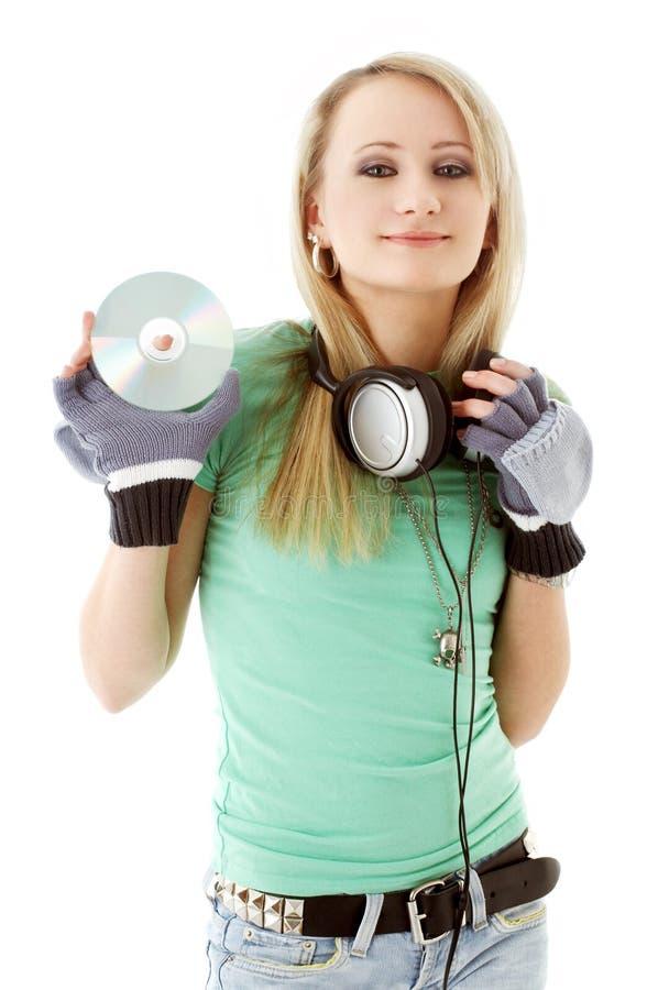 κράτημα ακουστικών κοριτ στοκ φωτογραφία με δικαίωμα ελεύθερης χρήσης