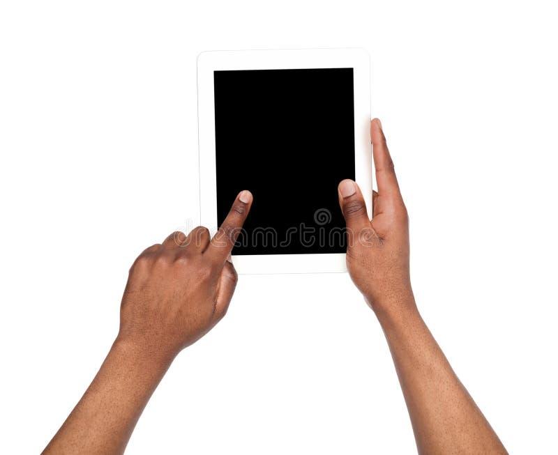 Κράτημα και υπόδειξη την κενή οθόνη στην ταμπλέτα στοκ εικόνες