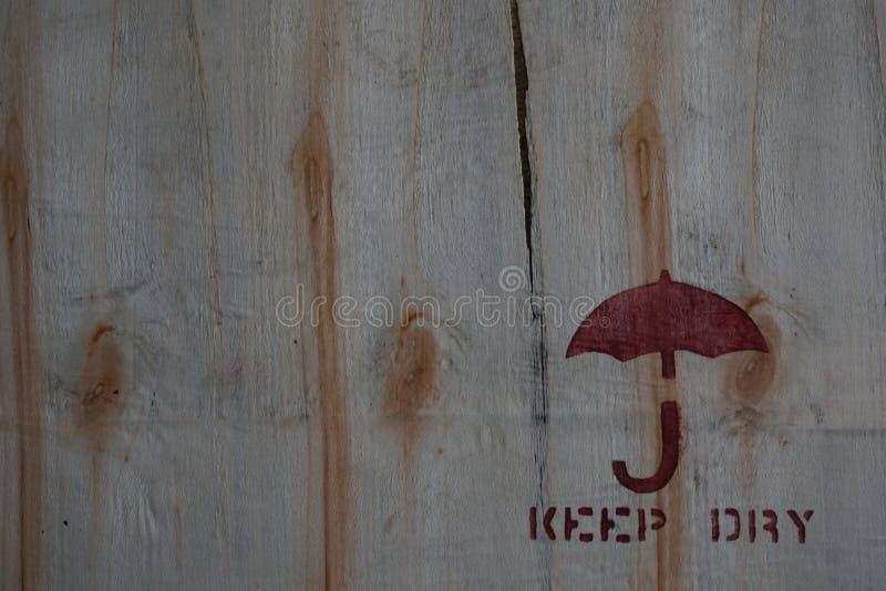 Κρατήστε το ξηρό εικονίδιο στον ξύλινο πίνακα στοκ φωτογραφίες με δικαίωμα ελεύθερης χρήσης
