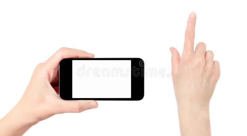 Κρατώντας το κινητό τηλέφωνο με να αγγίξει το χέρι που απομονώνεται στοκ εικόνες