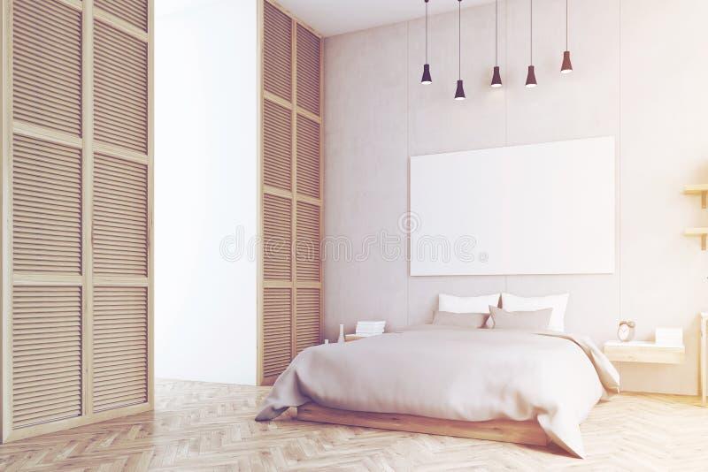 Κρεβατοκάμαρα με την αφίσα και ένα παράθυρο σε έναν μπεζ τοίχο, που τονίζεται στοκ εικόνες