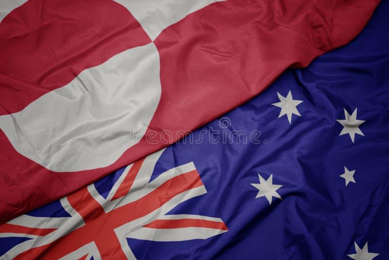 κυματίζοντας ζωηρόχρωμη σημαία της Αυστραλίας και εθνική σημαία της Γροιλανδίας στοκ εικόνες με δικαίωμα ελεύθερης χρήσης