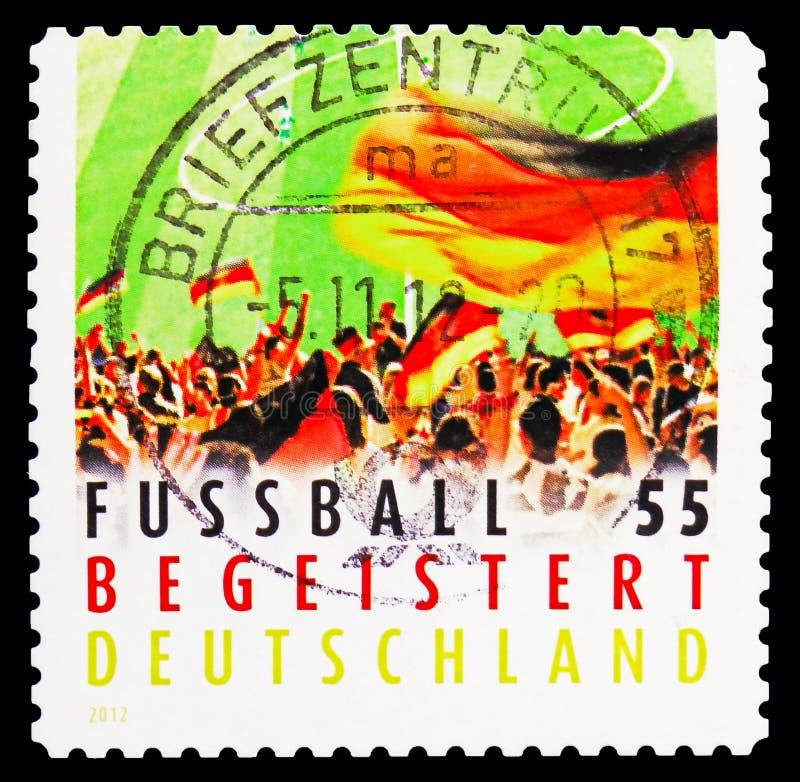 Κυματίζοντας σημαία πλήθους, γερμανικός ενθουσιασμός ποδοσφαίρου serie, circa 2012 στοκ εικόνες με δικαίωμα ελεύθερης χρήσης