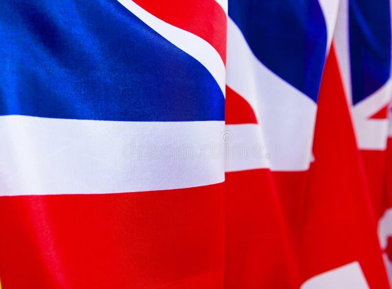 Κυματισμοί βρετανικών σημαιών στον αέρα Η θέση που διαφημίζει, πρότυπο στοκ εικόνα