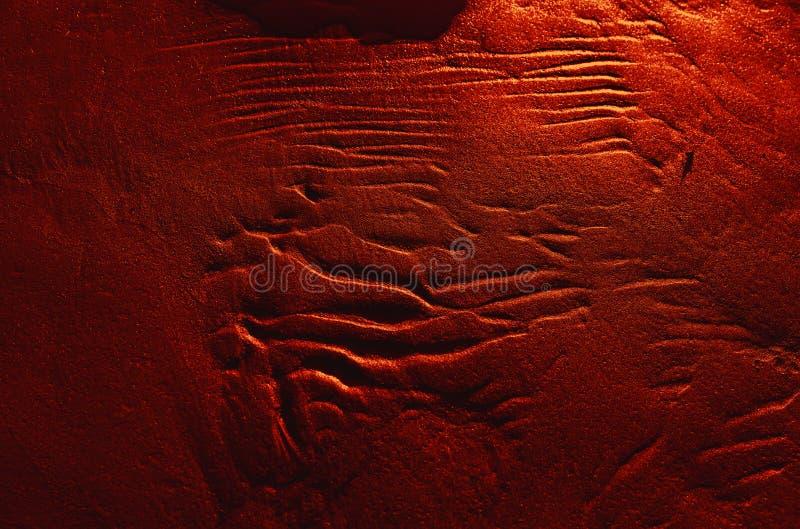 Κυματισμοί στην υγρή σύσταση υποβάθρου άμμου στοκ φωτογραφία