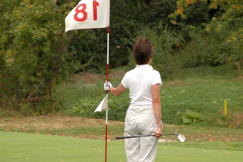 κυρία γκολφ σημαιών στοκ εικόνα