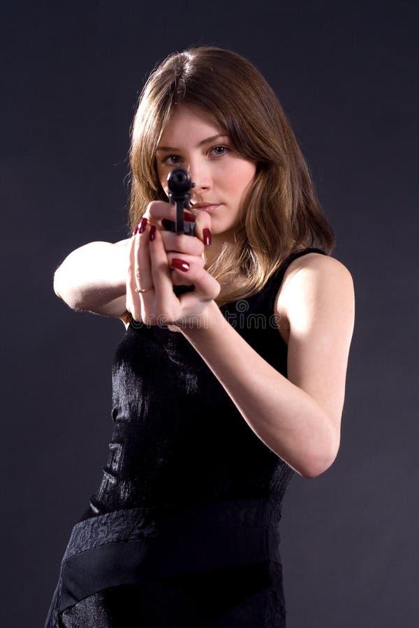 Κυρία και πυροβόλο όπλο στοκ εικόνα