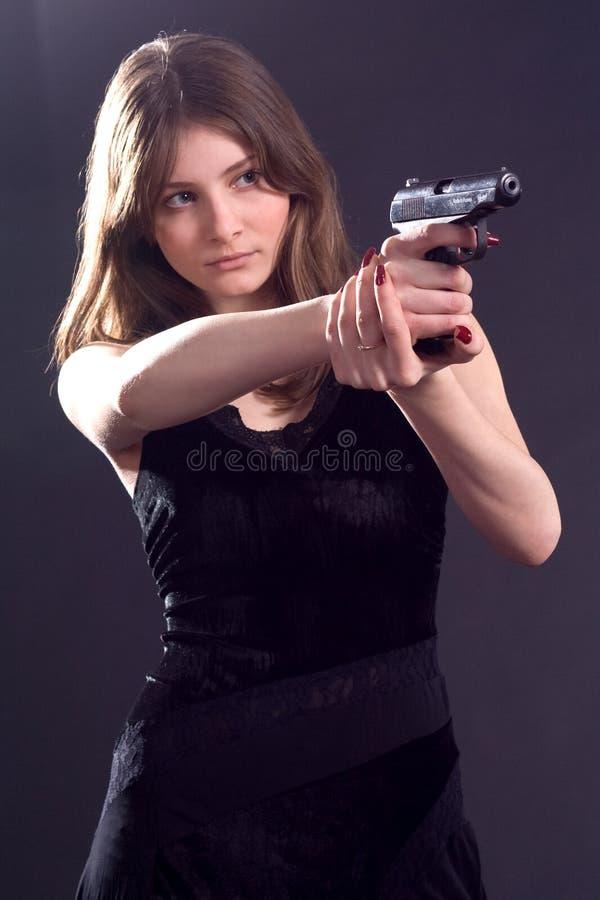 Κυρία και πυροβόλο όπλο στοκ φωτογραφίες