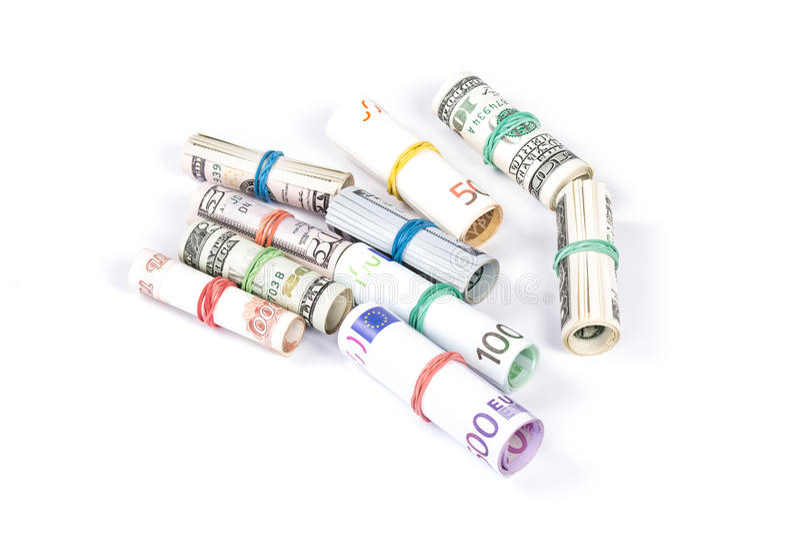 Κυλημένοι επάνω ευρο- και dolar λογαριασμοί στοκ εικόνες