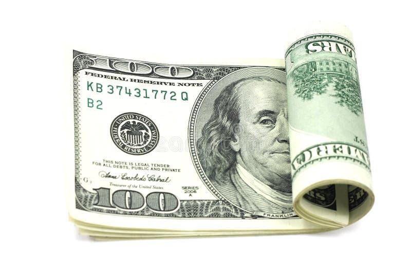 Κυλημένοι λογαριασμοί δ εκατό-δολαρίων στοκ φωτογραφία