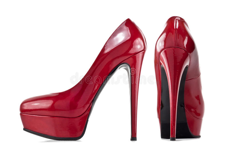 Κόκκινα θηλυκά παπούτσια με τα υψηλά τακούνια στοκ φωτογραφία με δικαίωμα ελεύθερης χρήσης