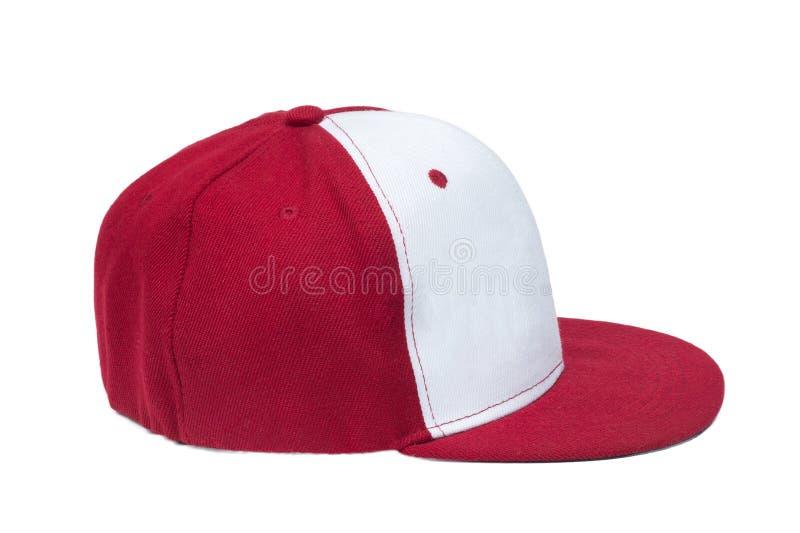 Κόκκινα και άσπρα καπέλα του μπέιζμπολ χρώματος στοκ φωτογραφίες με δικαίωμα ελεύθερης χρήσης
