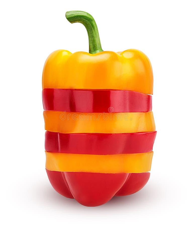 Κόκκινα και κίτρινα πιπέρια κουδουνιών φετών στοκ εικόνα
