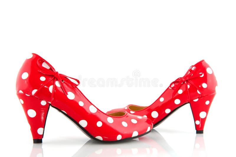 κόκκινα στίγματα παπουτσιών στοκ φωτογραφίες