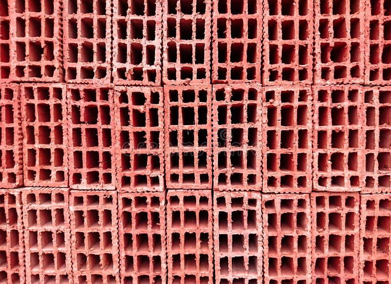 Κόκκινα τούβλα οικοδόμησης για την επένδυση στοκ φωτογραφία
