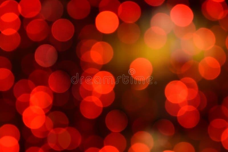 Κόκκινα Χριστούγεννα bokeh με τα ελαφριά υπέροχα μικρά φω'τα στοκ εικόνες