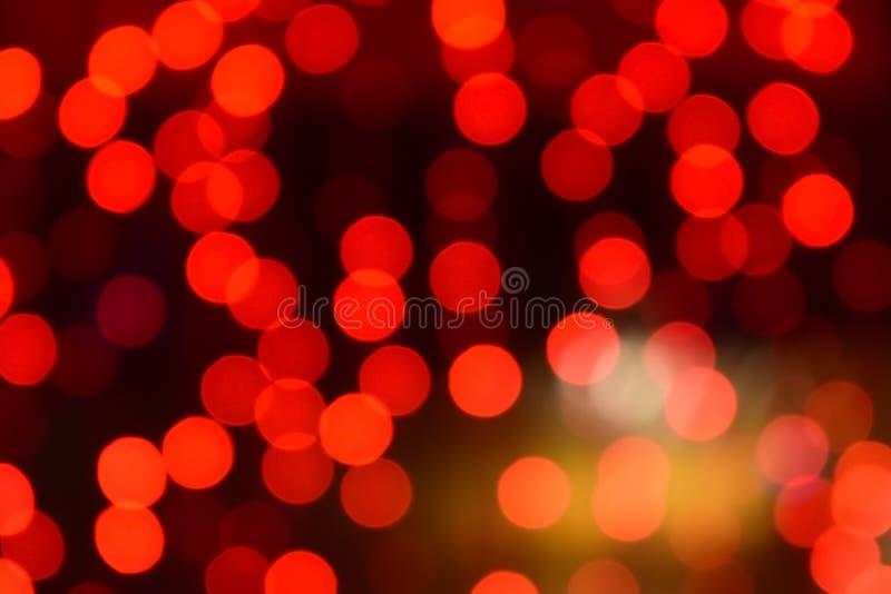 Κόκκινα Χριστούγεννα bokeh με τα ελαφριά υπέροχα μικρά φω'τα στοκ φωτογραφίες