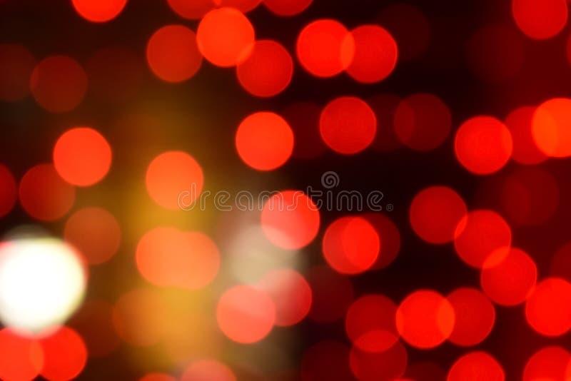 Κόκκινα Χριστούγεννα bokeh με τα ελαφριά υπέροχα μικρά φω'τα στοκ εικόνα με δικαίωμα ελεύθερης χρήσης