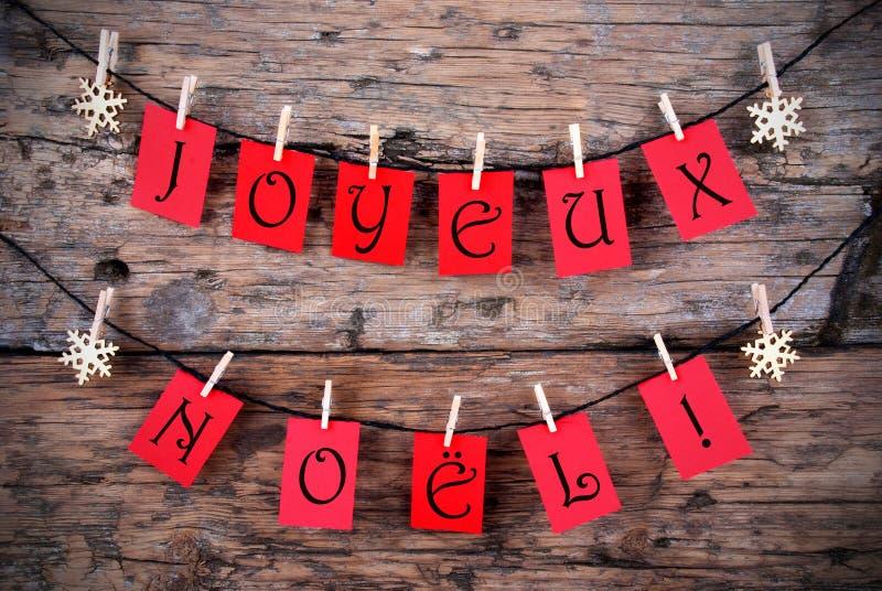 Κόκκινες ετικέττες με Joyeux Noel στοκ φωτογραφία με δικαίωμα ελεύθερης χρήσης