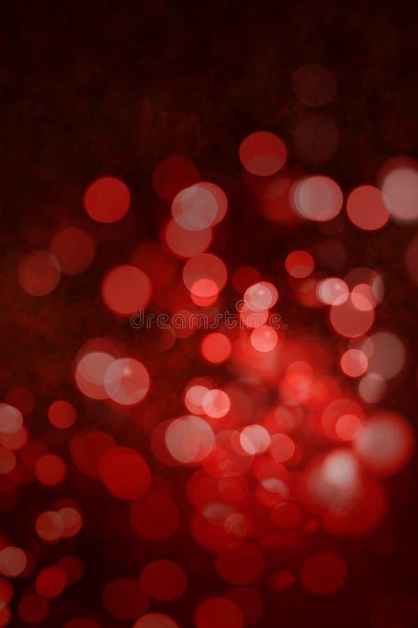 Κόκκινη αφηρημένη ανασκόπηση φω'των Χριστουγέννων στοκ εικόνα