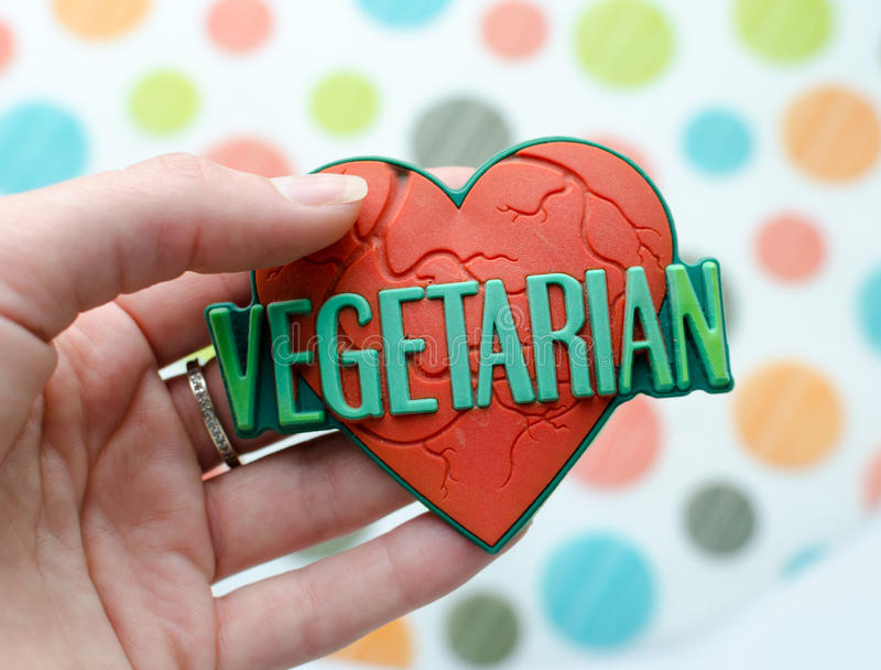 Κόκκινη καρδιά με τον παγκόσμιο χορτοφάγο στοκ εικόνες με δικαίωμα ελεύθερης χρήσης