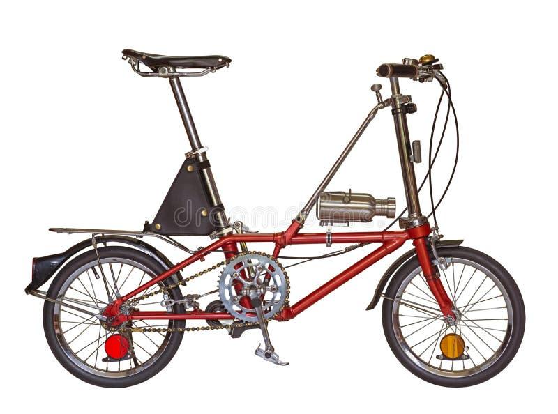 Κόκκινη μικρή ρόδα ποδηλάτων που απομονώνεται σε ένα άσπρο υπόβαθρο με το συνδετήρα στοκ φωτογραφία