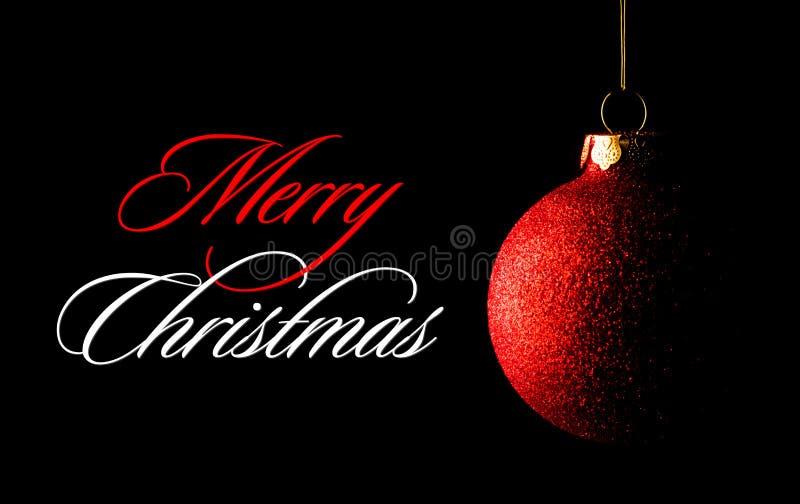 Κόκκινη σφαίρα Χριστουγέννων στο μαύρο υπόβαθρο χαιρετισμός καλή χρονιά καρτών του 2007 στοκ εικόνες