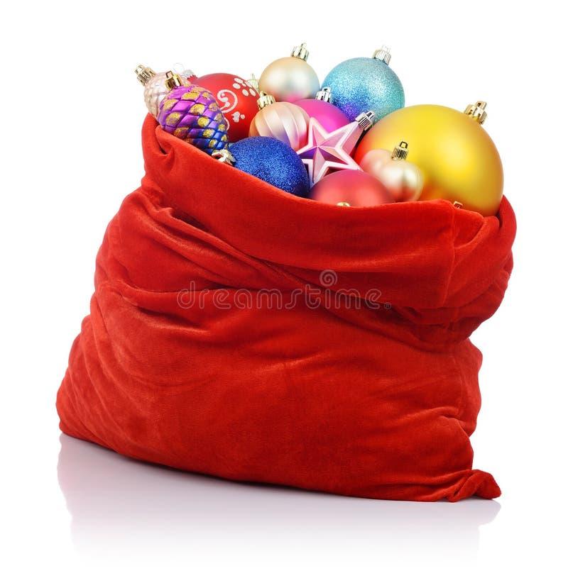 Κόκκινη τσάντα Άγιου Βασίλη με τα παιχνίδια Χριστουγέννων στοκ εικόνες με δικαίωμα ελεύθερης χρήσης