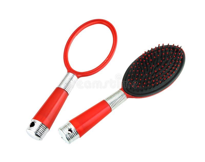 Κόκκινοι καθρέφτης και βούρτσα γηα τα μαλλιά χεριών στοκ φωτογραφία με δικαίωμα ελεύθερης χρήσης