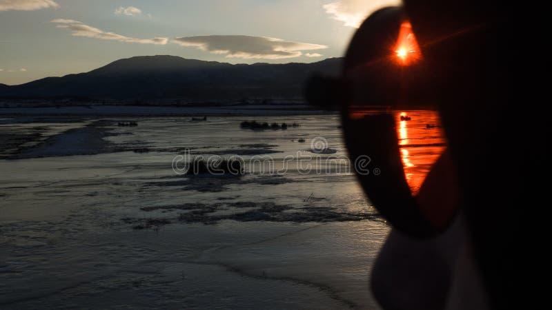 Κόκκινος ήλιος, μπλε ηλιοβασίλεμα στοκ εικόνες