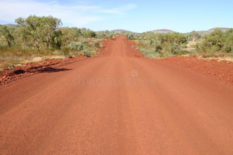 κόκκινος δρόμος αμμοχάλι& στοκ εικόνα
