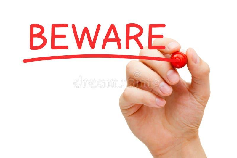 Κόκκινος δείκτης Beware στοκ εικόνες