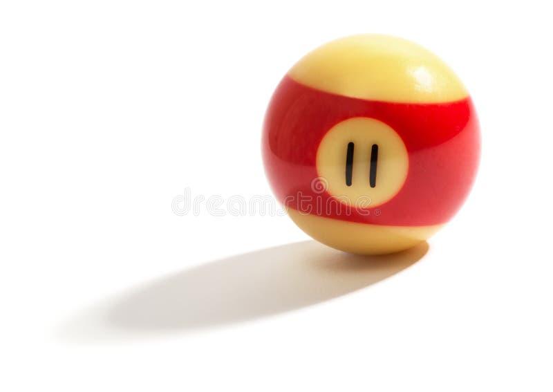 Κόκκινος και κίτρινος αριθμός 11 σφαίρα σνούκερ στοκ φωτογραφία