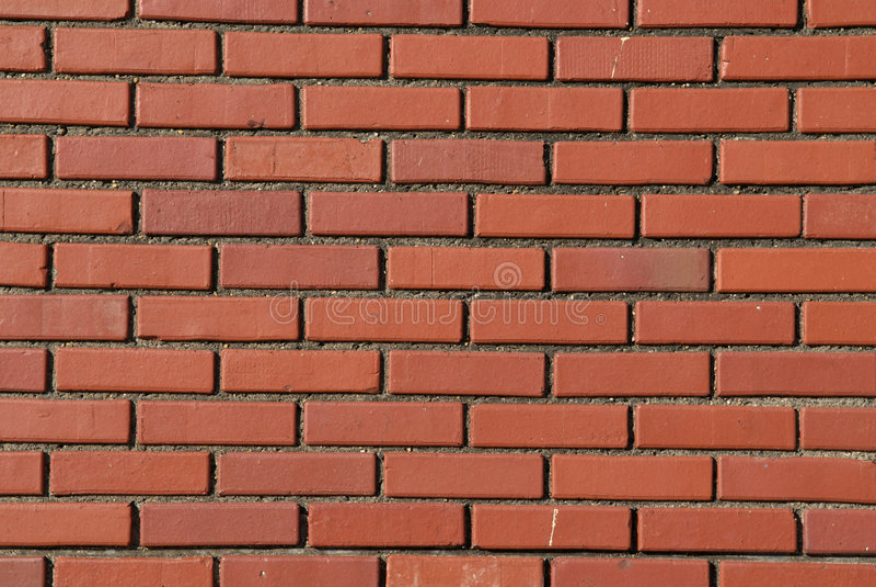 κόκκινος κανονικός τοίχος προτύπων τούβλου στοκ εικόνα