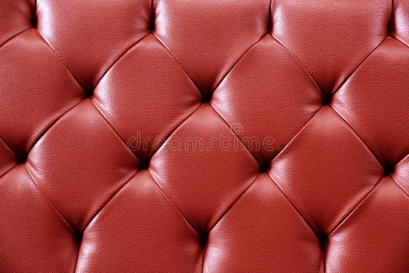 Κόκκινο δέρμα σύστασης για το υπόβαθρο Επαναλάβετε το πρότυπο στοκ εικόνα