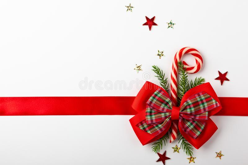 κόκκινο διάνυσμα κορδελλών Χριστουγέννων τόξων στοκ εικόνα