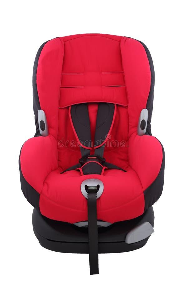 Κόκκινο κάθισμα αυτοκινήτων μικρών παιδιών απομονωμένος στοκ φωτογραφία με δικαίωμα ελεύθερης χρήσης
