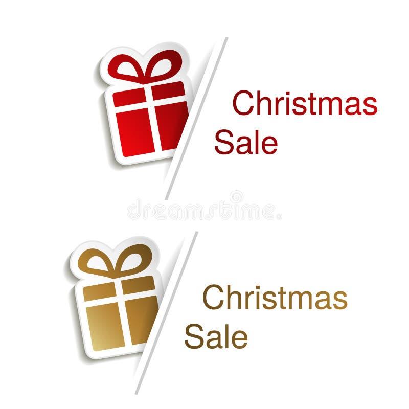 Κόκκινο και χρυσό δώρο Χριστουγέννων με την ετικέτα για τη διαφήμιση του κειμένου στο άσπρο υπόβαθρο, αυτοκόλλητες ετικέττες με τ ελεύθερη απεικόνιση δικαιώματος