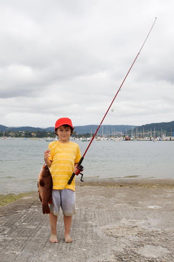 κόκκινο καπέλων ψαράδων πα& στοκ φωτογραφία