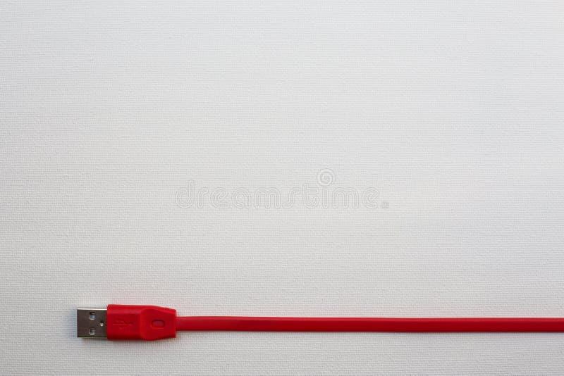 Κόκκινο καλώδιο USB στοκ φωτογραφία